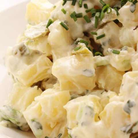 Recipe for Classic Potato Salad with Chives - A super simple salad that is always a hit at parties. The fresh chopped chives add a pop of color and delicious flavor. You can even add crushed garlic or finely chopped onion to take it up another notch!