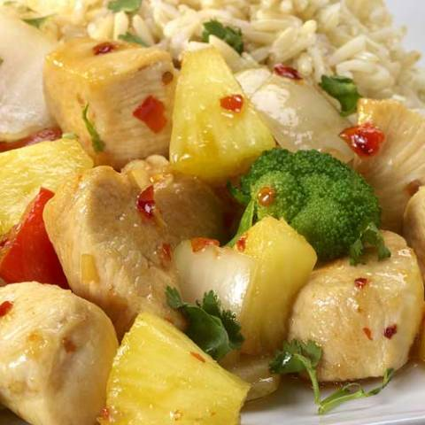 A deliciously sweet and savory dish featuring chicken, fresh pineapple and red bell peppers.