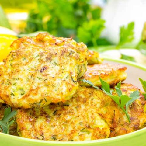 Recipe forZucchini Pancakes - Made with zucchini, these zucchini pancakes are a tasty change of pace from ordinary potato pancakes. Kick them up a bit by adding a little shredded onion to make them even more savory.