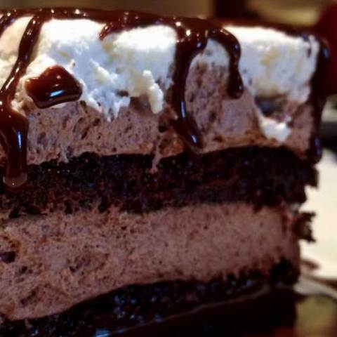 It takes a while to make this Chocolate Dream Cake, but is easy and oh so worth it! It is a HUGE hit at parties, summer barbecues, or any type of gathering!