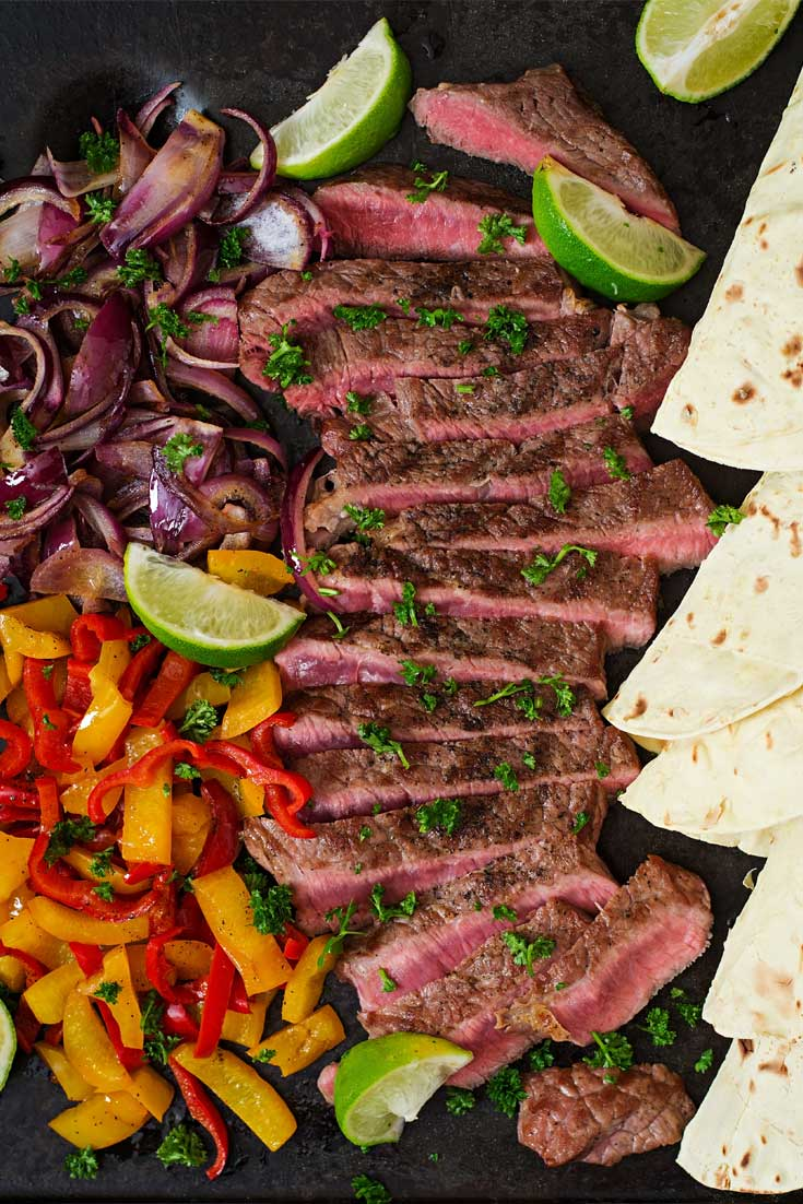 Enjoy your own Tex-Mex feast at home with this super-easy recipe for Margarita Steak Fajitas! Tequila and fresh lime juice are part of a marinade that gives these steak fajitas their bright flavor. #steak #fajitas #texmex #mexican #dinnerideas #easyrecipe
