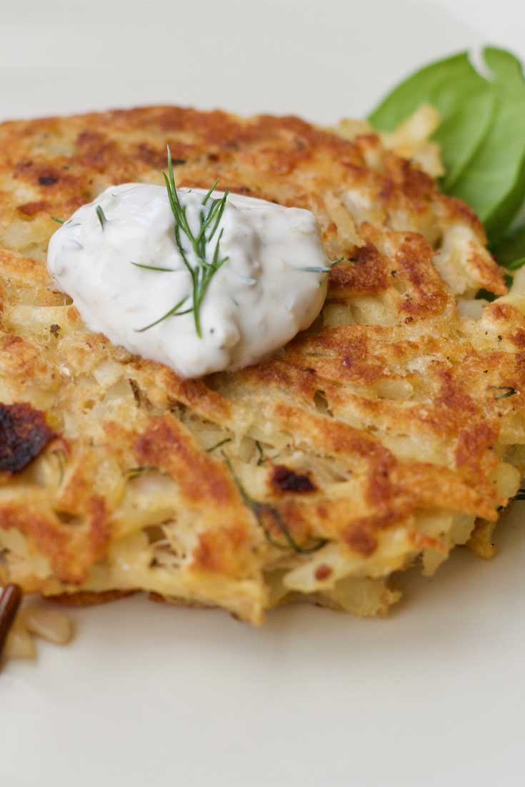 Frozen hash browns and flaked salmon come together for a twist on this traditional Swiss favorite, Salmon Rosti. We love the creamy dill sauce, but a little bit of ketchup is tasty too! #salmon #potatoes #Swiss #dinnerideas