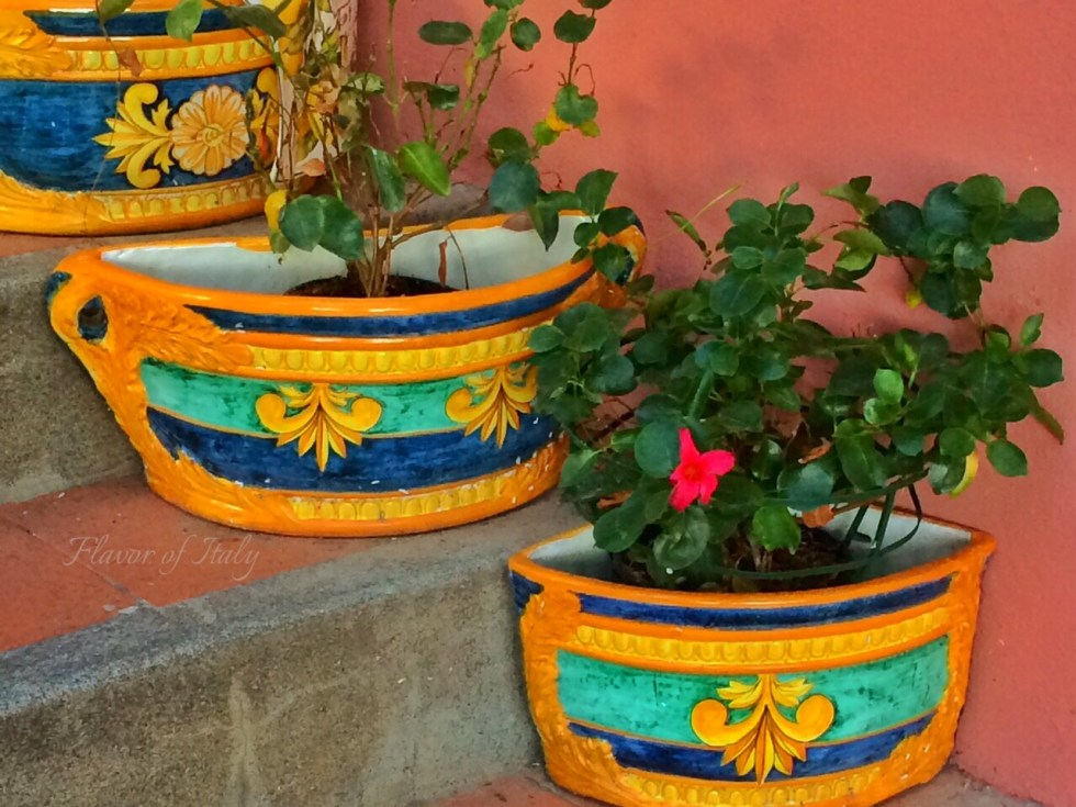 Hand-painted Vietri ceramic flower vases on the Casa Cosenza stairway