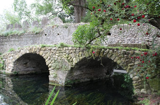 Ruins of an ancient stone bridge in the Ninfa Gardens