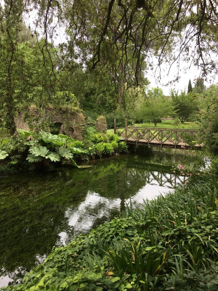 Wooden foot bridge and ruins in Ninfa Gardens
