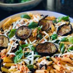 Penne pasta with eggplant is a luscious Sicilian dish. Fresh basil and salted ricotta add additional great flavor to the dish!