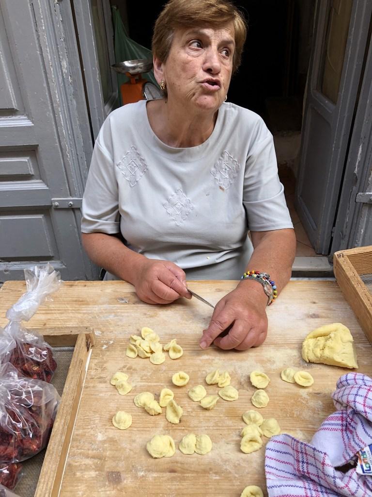 Woman in Bari Puglia making orecchiette