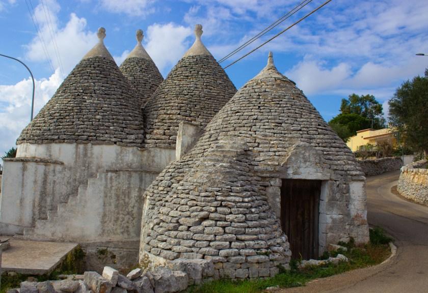 Trulli are a classical conical-shaped adobe in the Puglia region