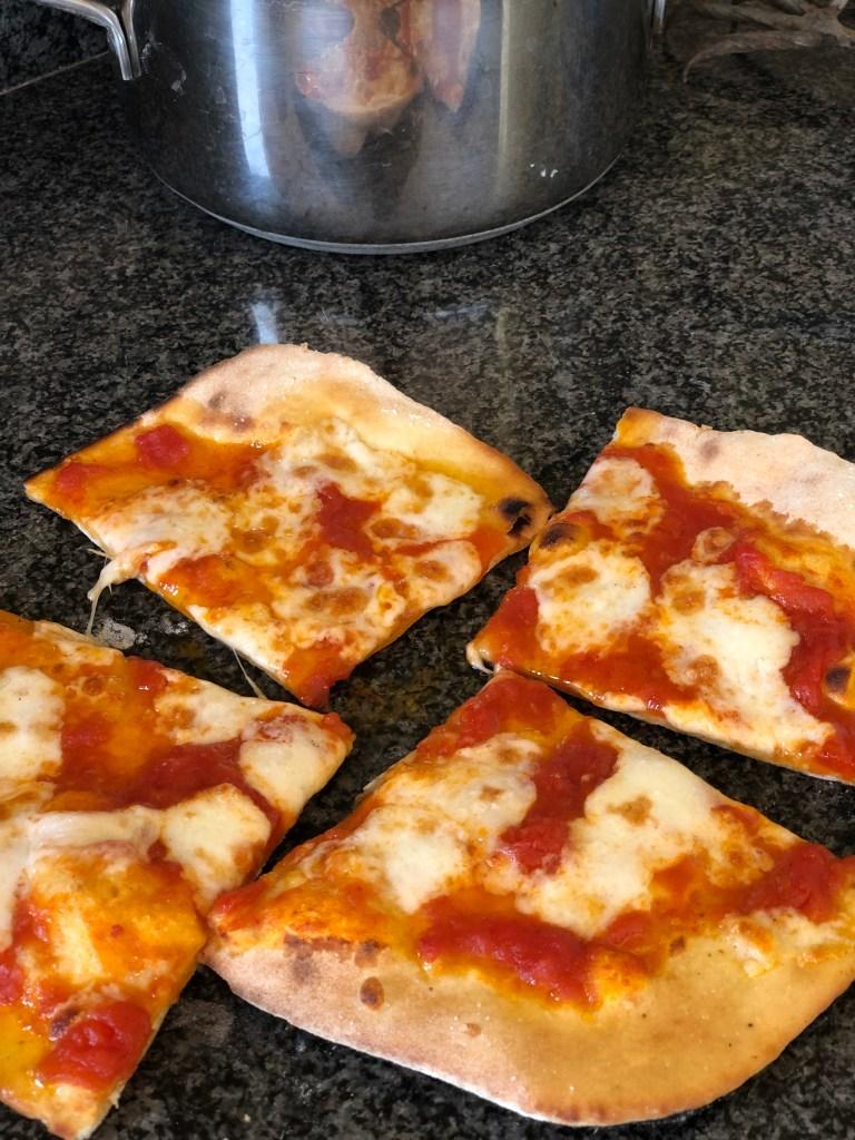 Margherita homemade pizza with tomato sauce and mozzarella
