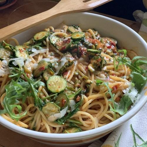 Umami rich 'Nduja Spaghetti with Slivered Zucchini and Arugula