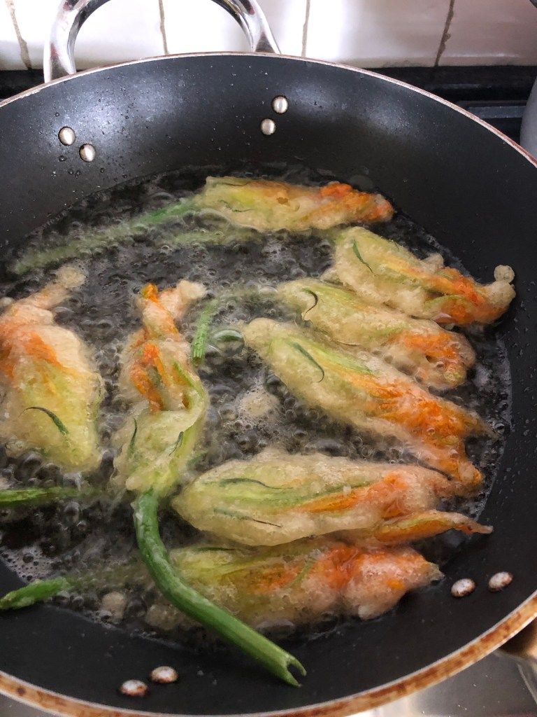 Cooking fried zucchini flowers