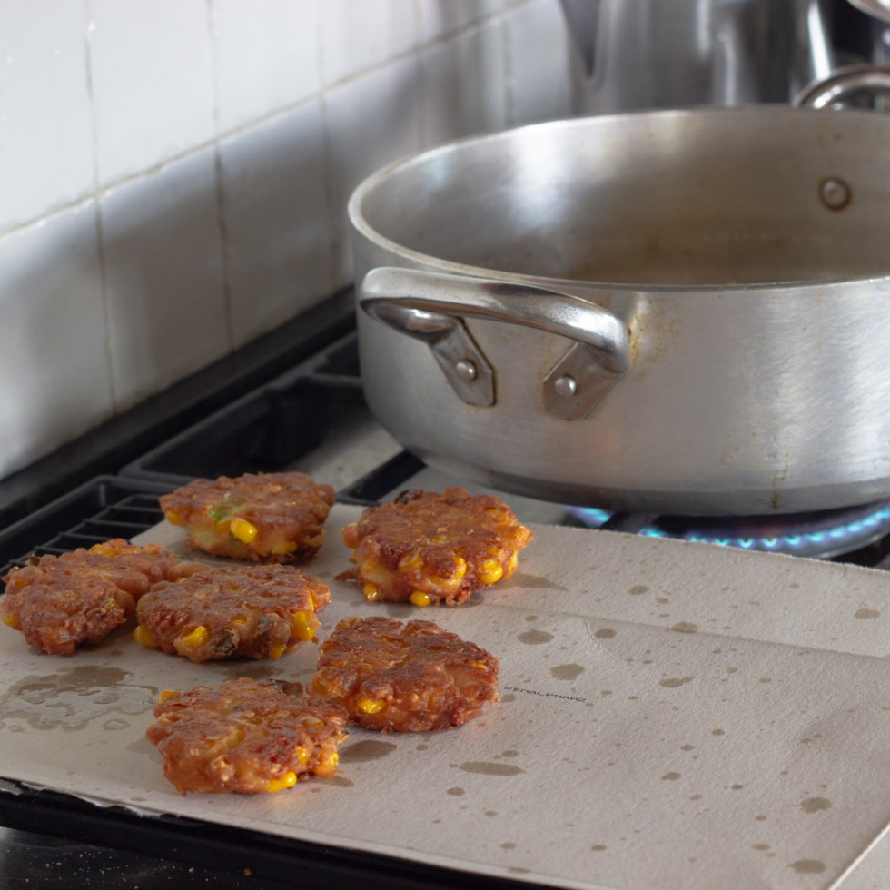 Drain corn fritters on used cereal boxes or other cardboard food boxes
