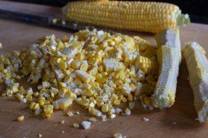 slice corn kernels off of the cob