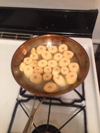 plantain discs in oil in pan