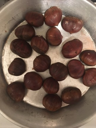 Chestnuts before roasting in pan