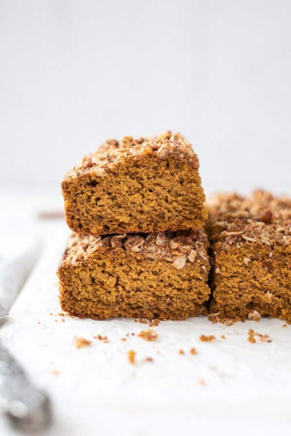 pumpkin coffee cake stacked up on a marble board