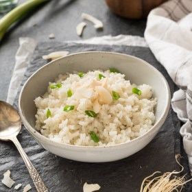 coconut rice in white bowl front view