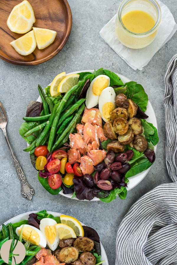 Salmon Nicoise Salad is a classic french salad with wild salmon tossed in a tangy lemon dijon vinaigrette! {GF}
