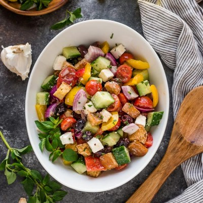 overhead shot of Greek panzanella in white bowl