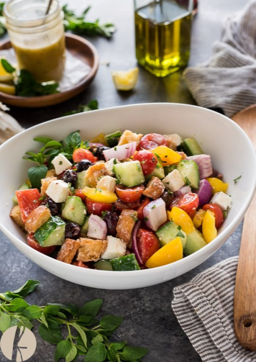 Greek Panzanella is a classic Greek village salad (horiatiki) tossed with crunchy homemade croutons and Greek salad dressing!