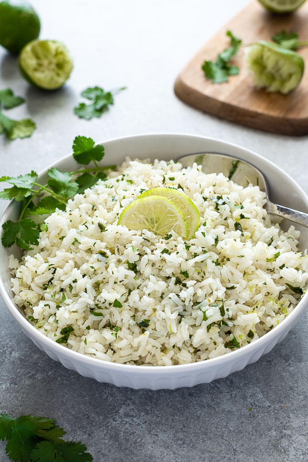 front shot of bowl of cilantro lime rice with cutting board in background