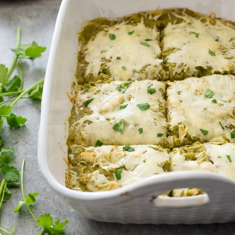 chicken enchilada bake cut into squares in baking dish