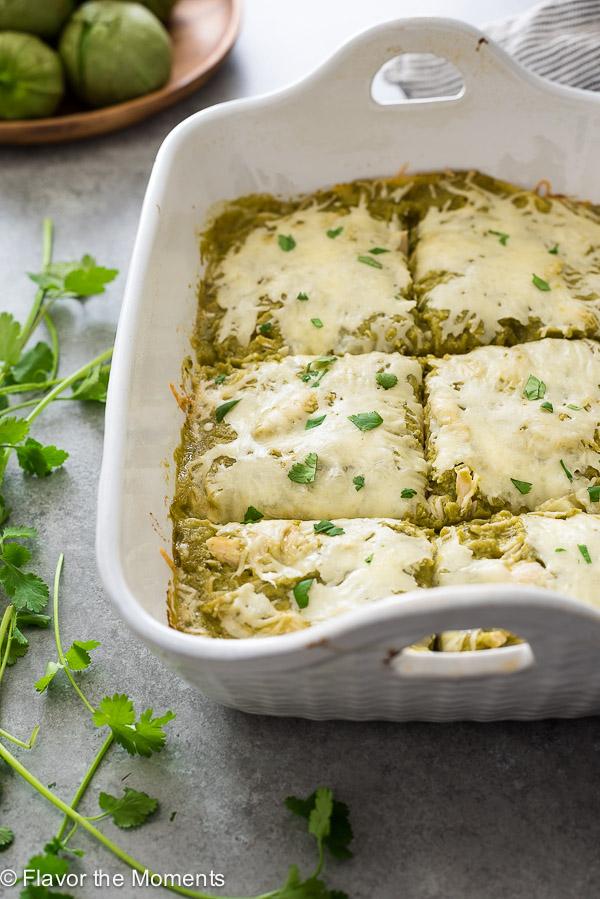 chicken verde enchilada casserole cut into squares in baking dish