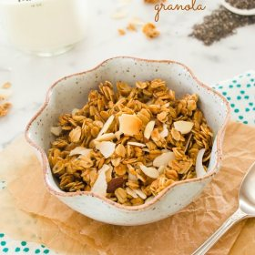 honey almond granola in a bowl with spoon