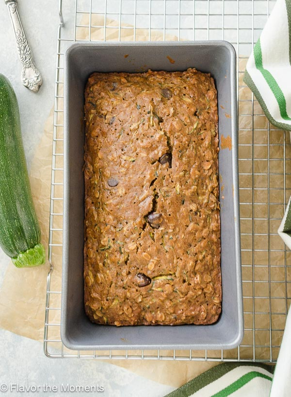 Oatmeal Coconut Chocolate Chip Zucchini Bread is a super moist whole grain zucchini bread studded with coconut and dark chocolate chips! @FlavortheMoment