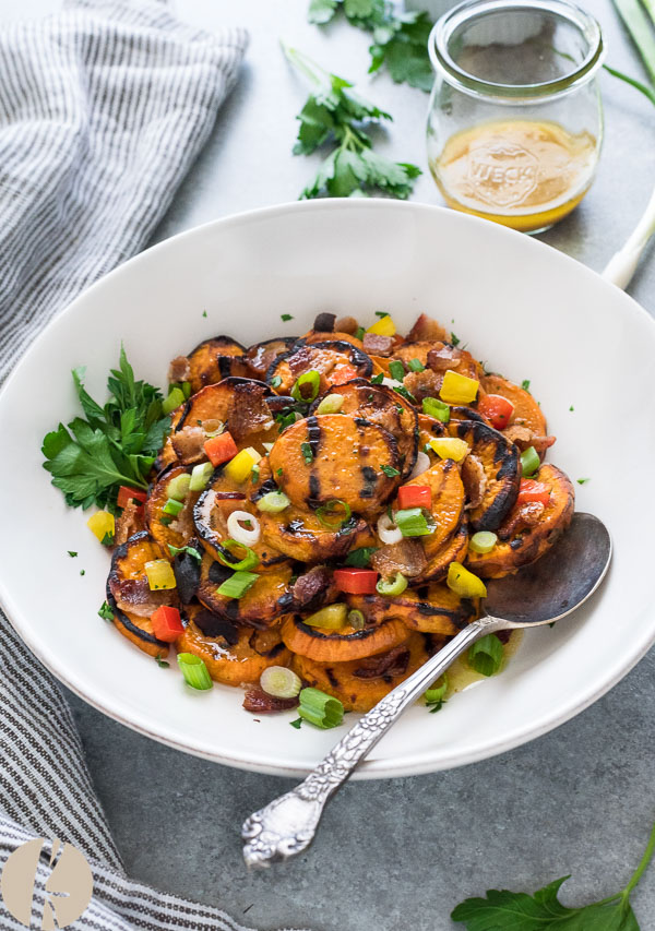Grilled Sweet Potato Salad with Maple Bacon Vinaigrette is smoky, charred grilled sweet potato with crumbled bacon and fresh veggies tossed in a maple bacon dressing!