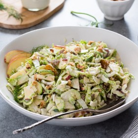 Shaved Brussels Sprout Salad with Apples, Bacon and Hazelnuts is a fresh, crunchy salad tossed in a creamy no mayo dressing!