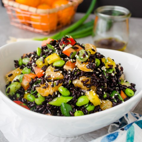 black rice salad pile high in a white bowl