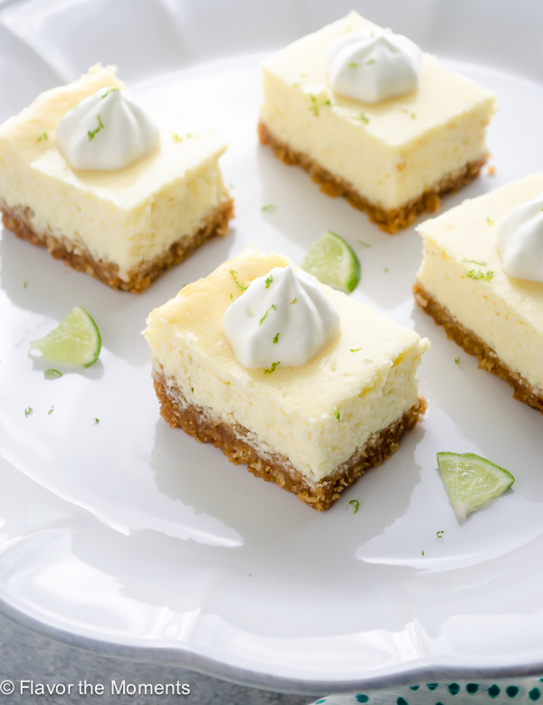 Key Lime Cheesecake Bars with Coconut Macadamia Crust are so easy to make, ultra creamy, and bursting with fresh key lime flavor! @FlavortheMoment