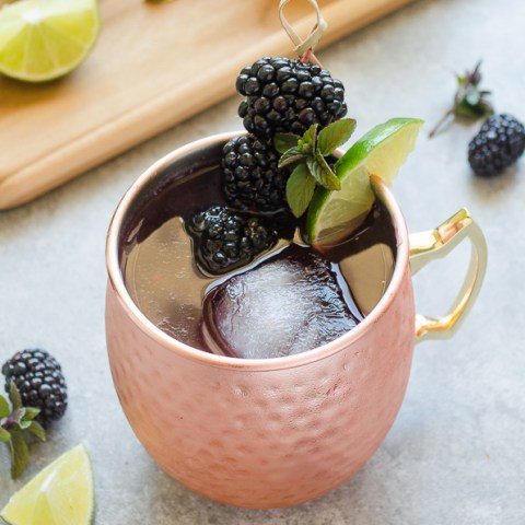 blackberry moscow mule with blackberries on a toothpick