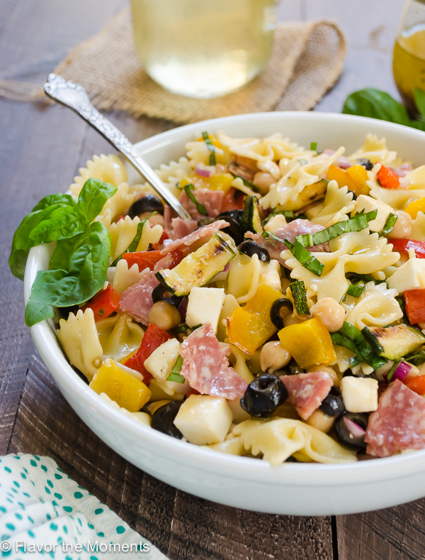 Italian Chopped Pasta Salad is everything you love about chopped salad in pasta form! Grilled zucchini and bell peppers make this the perfect summer side! @FlavortheMoment
