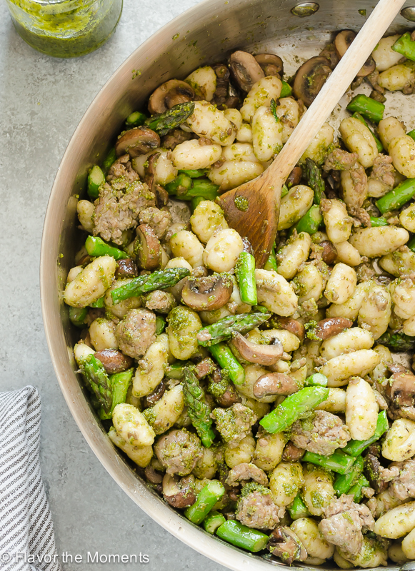 Pesto Gnocchi with Sausage, Asparagus, and Mushrooms is an easy meal packed with flavor and it's on the table in 30 minutes! @FlavortheMoment