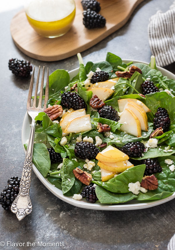 Power Green Salad with Pear and Blackberries is a nutritious blend of power greens, juicy pears, sweet blackberries, feta cheese, and toasted pecans tossed in an apple cider vinaigrette!