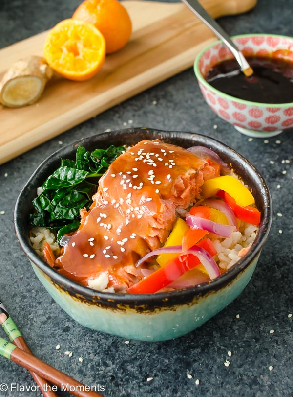 Maple Orange Teriyaki Salmon Bowls are salmon filets smothered in a sticky sweet teriyaki sauce with no refined sugar! It's so delicious you may never want takeout again. @FlavortheMoment