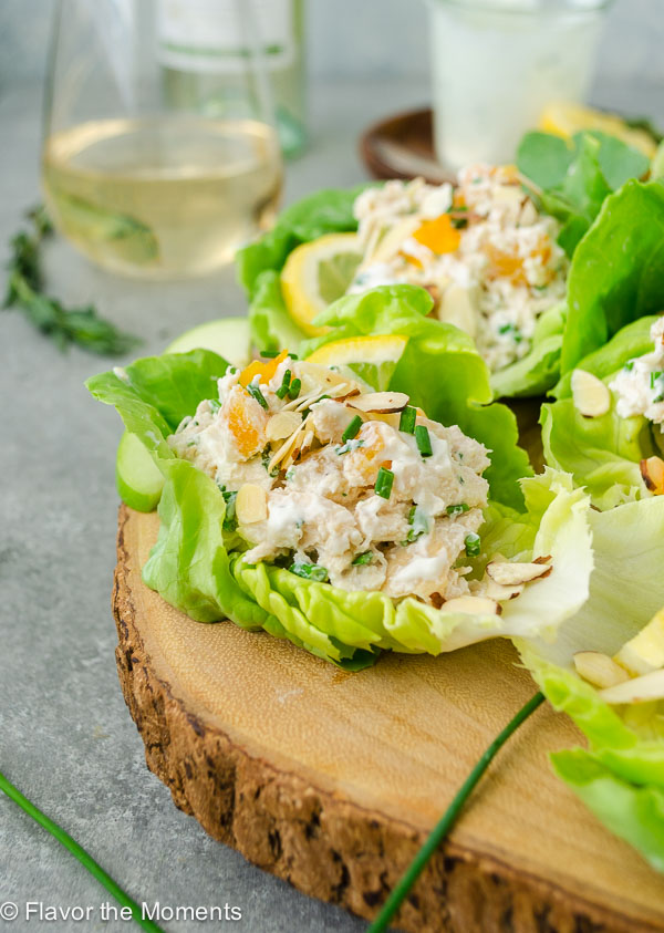 Lemon Tarragon Chicken Salad Lettuce Wraps are crisp lettuce cups filled with a low fat lemon tarragon chicken salad. They're light, low carb dish that's perfect for summer entertaining! flavorthemoments.com