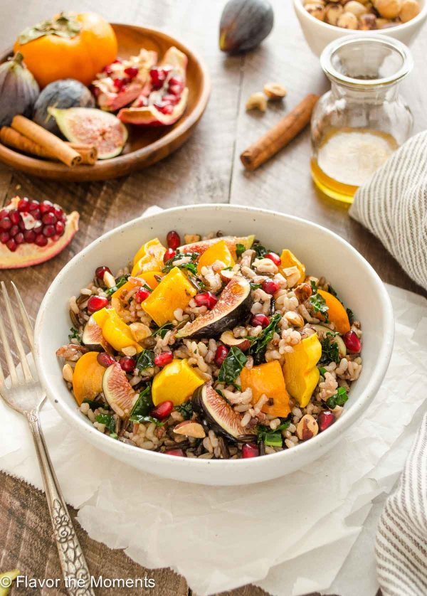 Wild Rice Kale Salad with Spiced Maple Vinaigrette is a vegan dish with roasted delicata squash, figs, persimmon, and pomegranate! {V, GF} @FlavortheMoment