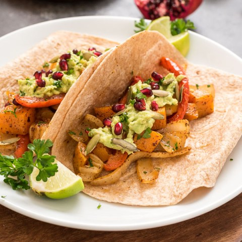 Roasted Butternut Squash Fajitas with Pomegranate Guacamole is a healthy, hearty vegan dinner that's on the table in under 45 minutes!
