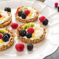 Breakfast fruit tarts on white pedestal