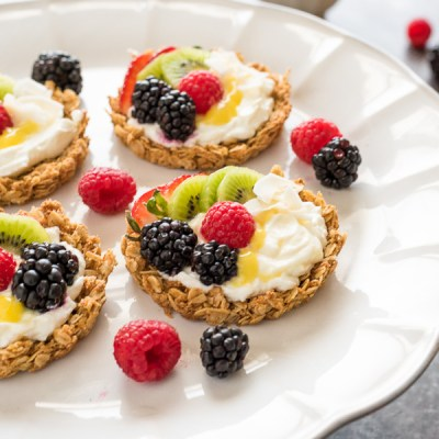 Breakfast Fruit Tarts with Granola Crust are crunchy granola tart shells filled with yogurt, homemade lemon curd and topped with fresh fruit! {GF, VEG}