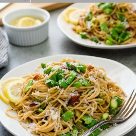 Spring Spaghetti Carbonara with Bacon is classic carbonara with whole wheat spaghetti, spring vegetables and bacon. It's the ultimate spring pasta!