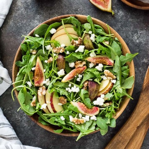 Apple Fig Arugula Salad with Goat Cheese and Walnuts is a delicious sweet and savory salad tossed in a cinnamon maple balsamic dressing!