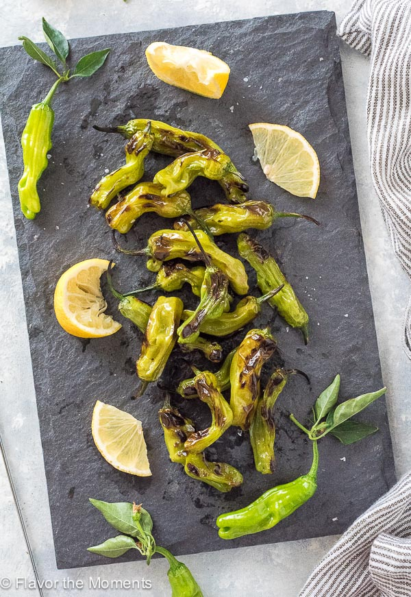 Grilled Shishito Peppers with Lemon and Sea Salt are smoky, charred shishito peppers served with fresh lemon and flaky sea salt!