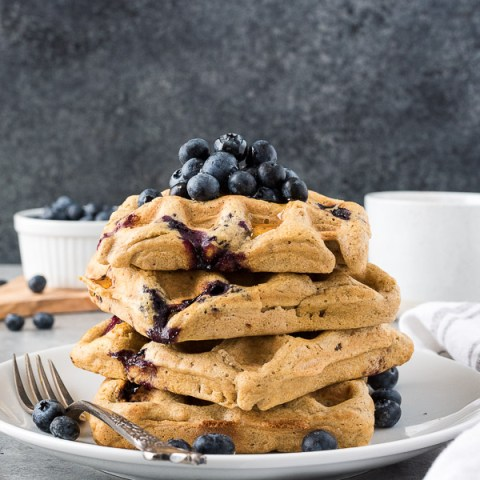 One Bowl Blueberry Oat Flour Waffles are crispy on the outside, fluffy on the inside, and studded with juicy blueberries.  They're gluten-free waffles that will surprise you!