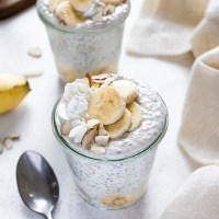 Jar of steel cut overnight oats topped with bananas