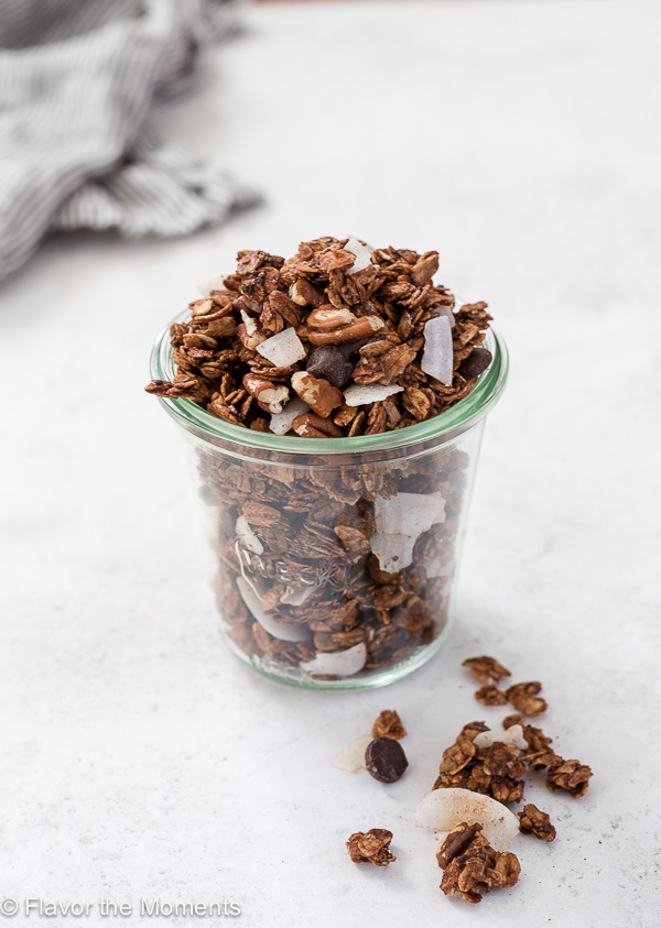 German Chocolate Granola is crunchy, big cluster chocolate granola with coconut and pecans. It's like german chocolate cake in a bowl! (GF, V)