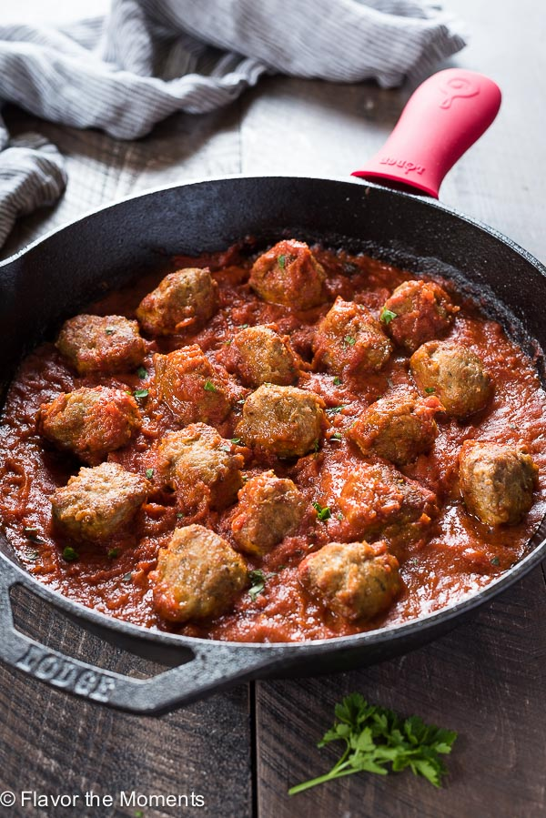 Paleo Turkey Meatballs with Zoodles is flavorful, grain free turkey meatballs cooked in marinara sauce. Serve over zoodles for a delicous low carb meal!